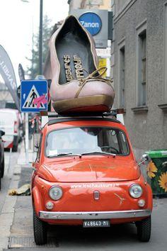 big shoe, little car - persimmon color fiat