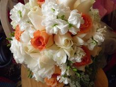 Bride's bouquet in peach and ivory roses, freesias, stock and lisi