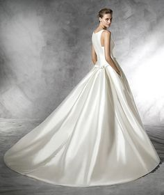 Barcaza | Bridal | Pronovias | Available at Lulu's Bridal Boutique | Lulu's Bridal | Dallas, Texas | Mikado | A line | Ball gown | High Neckline | High Back | Modest | Buttons | Bows | Pleated |