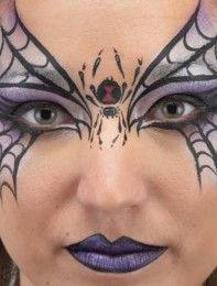 Add a red hourglass to the body of the spider for extra effect using a clean no. 3 round paintbrush. Outline the lips in black, then fill them in with metallic purple after cleaning the paintbrush.This face painting idea is from 'Extreme Face Painting: 50 Friendly