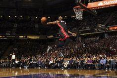 LeBron James of the Miami Heat dunks the ball