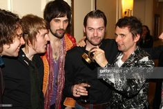 L-R Ian Matthews, Chris Edwards, Sergio Pizzorno, Tom Meighan and Matt Bellamy pose with Muse's Best Act in the World award at the 2009 Q Awards held at the Grosvenor House Hotel on October 26, 2009 in London, England.