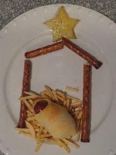 Pigs in a blanket baby Jesus Christmas manger food. Who thought this was a good idea? I can't stop laughing!