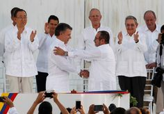 Colombian President Juan Manuel Santos (left) and Marxist rebel leader Timochenko shake hands after signing an accord ending a half-century war that killed a quarter of a million people, in Cartagena, Colombia, on September 26, 2016. Although a referendum vote earlier in the year rejected a version of the peace accord, a revised agreement was ratified in November, and FARC rebels were to begin disarming and demobilizing in early December.