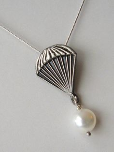 NEED: It is the pearl from peeta! Yet, it also looks like a sponsor parachute! Hehe :)
