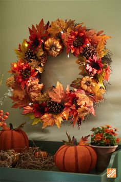 Show off the colors of fall with this harvest wreath. It features a beautiful assortment of aging leaves with pinecones and pumpkin accents. The wreath comes pre-lit with 15 LED lights that reflect off the glittered pumpkins to create a captivating display. Perfect for the entryway, door or mantel!