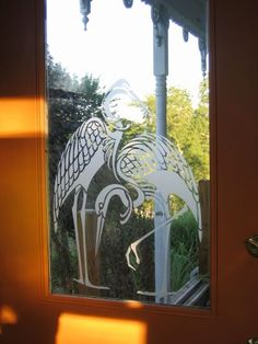 stencil on window glass.  Acrylic paint with stencil of ferns...
