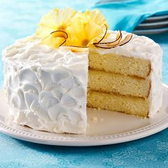 Pina Colada Cake Recipe -As an avid baker, I wanted to create something that was mine and from my heart. I wanted to make a cake that tasted like the perfect pina colada drink, and I feel like I accomplished just that with this recipe. —Stephanie McShan, Apopka, Florida