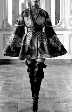 LOVE the coat.. the thigh high boots.. not so much. Coat:  Alexander McQueen