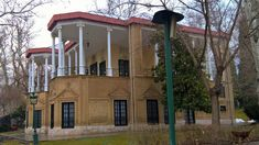 Ahmad Shahi Pavilion is located in the Niavaran Complex, in the north of Tehran, Iran. Ahmad Shahi Pavilion is beside Mohammad Reza Pahlavi's dwelling, Niavaran Palace and the oldest building there, Sahebgheranieh Palace. The Pavilion was built at the end of the Qajar era as Ahmad Shah's dwelling among Niavaran garden Tehran Iran, Old Building, Pavilion, Palace, Photo Galleries, Old Things, Mansions, House Styles, Garden