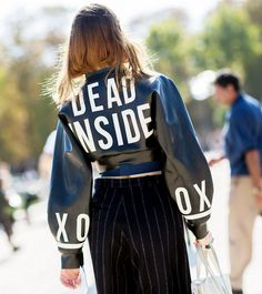 Graphic leather jacket creates a statement with pinstriped trousers. // Photo: The Stylograph #PFW #streetstyle