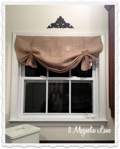 How to make a no-sew DIY burlap window valance using burlap, twine, and thumbtacks. Step by step tutorial at 11 Magnolia Lane. No Sew Curtains, Rod Pocket Curtains, Cafe Curtains, Kitchen Window Valances, Kitchen Windows, Burlap Kitchen Curtains, Farmhouse Valances, Country Valances, Country Curtains