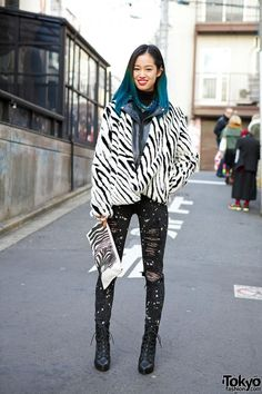 "When we met this 19-year-old girl with blue ombre hair in #Harajuku, she told us her name was ""L"". Her look features an H&M zebra coat with a zebra clutch, a spiked ear cuff, ripped Glad News jeans and heeled boots. #tokyofashion #street snap"