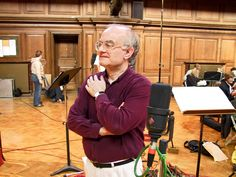 """English composer and conductor John Rutter, CBE, during the May 2003 recording session for his """"Mass of the Children"""" in London with The Cambridge Singers. (c) David Henderson"""
