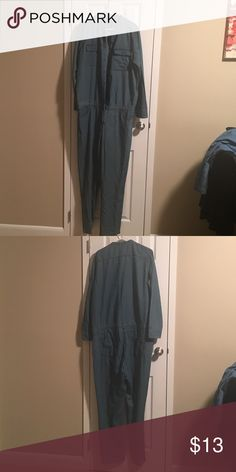 Denim jumpsuit Denim jumpsuit with draw string at the waist.  3 buttons are missing.  They can be easily be replaced. It's a size 21 Pants Jumpsuits & Rompers