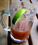 Michelada: Mexican Beer Cocktail • Alternative: 1 teaspoon kosher salt • 1/2 teaspoon pure chile powder • 1 lime, halved • 2 tablespoons fresh lime juice • 1 teaspoon Worcestershire sauce • Dash of hot sauce • 1 (12-ounce) chilled beer (preferably Mexican and dark)