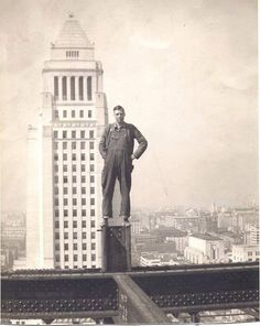 Man tops out the Federal Courthouse (in front of the City Hall tower), Los Angeles, 1938