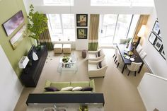 I adore the judicious use of olive green in this otherwise neutral, open room.