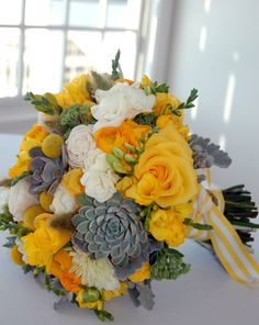 Yellow roses, yellow and white freesia, succulents, ranunculus and billy balls. What a sunny wedding bouquet!