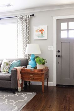 This weekend we are spending our time painting our living room barely grey. I'm totally in love with this color.