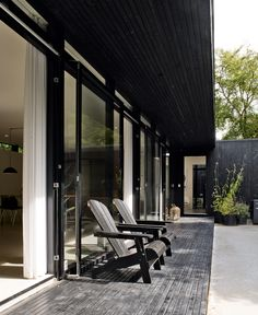 Black Adirondack Chairs - Danish summer house | NordicDesign