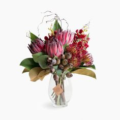 Contemporary floral styling using the highest quality, realistic, florist selected artificial flowers. Australia's most realistic fake flower arrangements and bouquets, artificial wedding flowers and artificial plants. Flor Protea, Protea Flower, Flower Vases, Artificial Flower Arrangements, Vase Arrangements, Artificial Flowers, Modern Floral Arrangements, Coral Wedding Flowers, Flower Bouquet Wedding