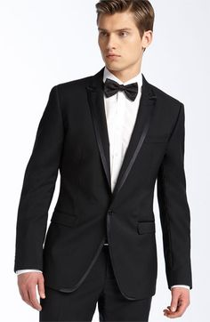 Suit with bow-tie. Classy, but laid-back at the same time