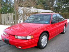 1998 Red Oldsmobile Cutless Supreme.