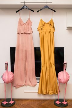 Inside Photographer Nima Benati's Closet and Milan Home: A separate room housed her floor-length slip dresses, Attico wraps, and wide-legged hardwood-grazing trousers. In front of the lens, she was just as natural as behind it. See it all for yourself by clicking through below. -- Long ruffled pink and yellow gowns | coveteur.com