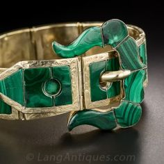 From mid-nineteenth century Scotland, and as green as the bonnie highlands!, comes this superb buckle bracelet crafted in 9K gold and inlaid with numerous malachite plaques set into engraved hinged frame sections with a fancy buckle clasp. This wonderful, flexible  bracelet does show some wear after 150 plus years of enjoyment. A few of the Malachite plaques are fissured and the gold is well worn throughout;nevertheless, this bracelet is still fabulous and is in eminently wearable condition.