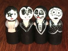 These four little guys are a tribute to the classic 80s Rock Band KISS! Gene even has his tongue out!! They are hand painted on 2 3/8 dolls. They are a perfect gift for the KISS collector