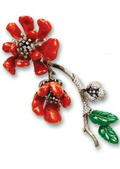A red coral, jadeite and diamond brooch Designed as a spray of flowers and foliage, the largest flower and two smaller detachable blooms with carved red coral petals and rose-cut diamond stamen mounted en tremblant, the remaining two detachable blooms with white gold petals and similarly set stamen, contrasted by two carved emerald green jadeite leaves of good translucency and enhanced by a textured stem with pavé-set brilliant cut diamonds.