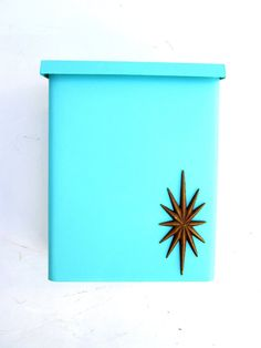 mid-century turquoise metal mailbox