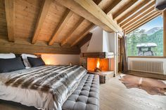 What a cozy bedroom in Val d'Isere! Chalet Yeti #interior #interiordesign #fireplace #bedroom #cozy #holidays #travel #winter #skiresort