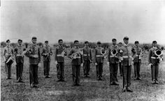 The original 13 members of the Fightin' Texas Aggie Band, 1894.