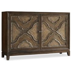 Craft an eye-catching vignette in your living room or entryway with this lovely console table, Showcasing 2 doors and quatrefoil carved fronts.