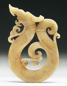 """A Chinese Archaic Jade Pendant: finely carved as an dragon in flight, the jade of yellowish grey color, of Warring Period  Dimensions: H: 4-3/4"""""""