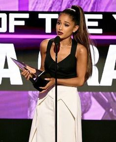 Ariana won the AMA award Artist of The Year-and she totally deserved it.The award showcase her incredivle work and what she's done for us.