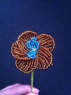 Bead flower small orchid topaz-blue, for sale at ellensbeadflowers.webs.com
