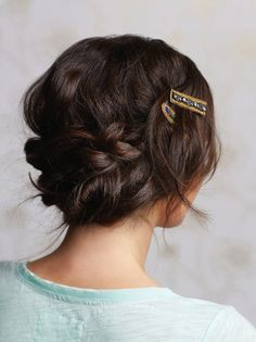 Love the whimsical detailing in these barrettes + braids.