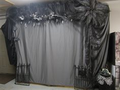 Halloween photo booth, Halloween picture background. Cross's carved from potato's and dried.  Two plastic ferns wired together and painted along with thrift store flowers.