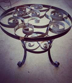 Dining table made from retired wine barrel rings! Includes glass top can be made in any size and can be used inside or out. We love these!