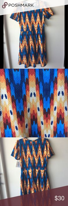LuLaRoe Blue and Orange Print NWT Amelia Dress LuLaRoe Print NWT Amelia Dress, great for casual, work and party wear! PERFECT NEW CONDITION. LuLaRoe Dresses
