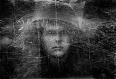 Philip Jones Griffiths, , Portrait of a British soldier taken though his scratched Plexiglas riot shield. Belfast 1973