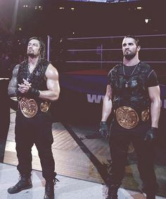 roman reigns with tag team gold  | Roman Reigns and Seth Rollins, the tag team champions