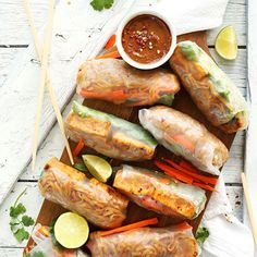 Pad Thai Spring Rolls With Extra Firm Tofu, Brown Rice Noodles, Brown Rice, Sliced Carrots, Fresh Cilantro, Tamarind Concentrate, Tamari Soy Sauce, Coconut Sugar, Lime, Garlic Chili Sauce, Peanut Sauce, Sriracha