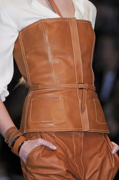 Hermès Spring. Brown faux leather: http://www.MJTrends.com/products.Brown,Matte-Vinyl,Fabric