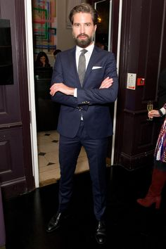 Britain's best bearded man shows you why navy will never go out of style at the Tommy Hilfiger & Jonathan Newhouse Dinner on Sunday night.