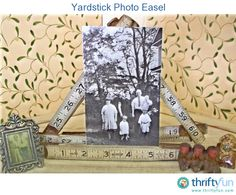 I love anything old with numbers on it.  I'm funny that way.  Here's a couple of old folding yardsticks that became frames for my photos.  I like the b/w photos for these.  Just bend the yardsticks into the shape you like and tuck your pictures in between.