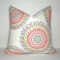 Pink Yellow Aqua Blue Green Red Medallion Pillow Cover  This fabric has a very cool linen look to it. A bold statement for any room!  Size 18x18  Same fabric front and back *Pattern placement will vary*  I cut all my covers at the advertised size and once sewn will be about 3/4-1 smaller. This is so itll be a great snug fit over the same size inserts available in my shop. :)  All my pillow covers have zipper closure! Handy for covering all your current inserts.  Pillow inserts not inclu...